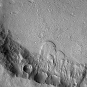 Several landslide deposits are visible in this image captured by NASA's 2001 Mars Odyssey spacecraft of an unnamed crater in Terra Cimmeria.