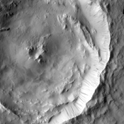 Dark slope streaks mark the rim of this unnamed crater as seen by NASA's 2001 Mars Odyssey spacecraft.