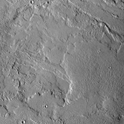 This image from NASA's 2001 Mars Odyssey spacecraft shows some of the extensive volcanic flows east of the large Tharsis volcanoes.