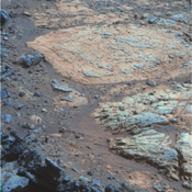 A rind that appears bluish in this false-color view covers portions of the surface of a rock called 'Whitewater Lake' in the top half of the view from NASA's Mars Exploration Rover Opportunity.