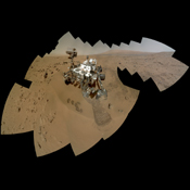 The mosaic shows NASA's Curiosity rover at 'Rocknest,' the spot in Gale Crater where the mission's first scoop sampling took place. Four scoop scars can be seen in the regolith in front of the rover.