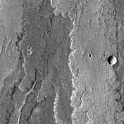 Layer upon layer of volcanic flows make up Daedalia Planum as shown in this image from NASA's 2001 Mars Odyssey spacecraft.
