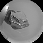 The shape of the tip of the bit in the drill of NASA's Mars rover Curiosity is apparent in this view recorded by the remote micro-imager in the rover's ChemCam instrument on Mars. Jan. 29, 2012; the bit is about 0.6 inch (1.6 centimeters) wide.