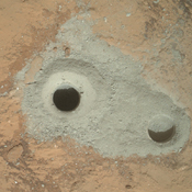 At the center of this image from NASA's Curiosity rover is the hole in a rock called 'John Klein' where the rover conducted its first sample drilling on Mars.