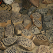 The development of the Mars rover Curiosity's capabilities for drilling into a rock on Mars required years of development work. Seen here are some of the rocks used in bit development testing and lifespan testing at JPL in 2007.