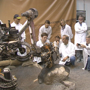 This frame from a video clip shows moments during a demonstration of drilling into a rock at NASA's JPL, Pasadena, Calif., with a test double of the Mars rover Curiosity. The drill combines hammering and rotation motions of the bit.