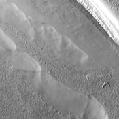 Many different surface textures are found on the polar caps. This image captured by NASA's 2001 Mars Odyssey spacecraft shows part of the surface of the south polar cap.