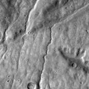 This image from NASA's 2001 Mars Odyssey spacecraft of the Claritas Fossae region illustrates how fractures affect other features. In this instance, the fractures control the path of several channels (from upper right towards lower left).