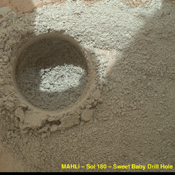 After an activity called the 'mini drill test' by NASA's Mars rover Curiosity, the rover's MAHLI camera recorded this view of the results. The test generated a ring of powdered rock for inspection in advance of the rover's first full drilling.