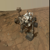 This self-portrait of NASA's Mars rover Curiosity combines dozens of exposures to show gray-powder and two holes where Curiosity used its drill on the rock target 'John Klein'