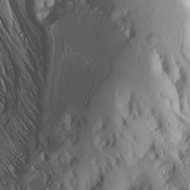 This image captured by NASA's 2001 Mars Odyssey spacecraft shows the rough terrain just inside the eastern rim of Gale Crater as well as the eastern extent of Mr. Sharp.