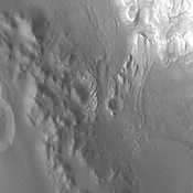 Backtracking a bit, this image from NASA's Mars Odyssey spacecraft shows the large channel in the upper left of the frame. Just below the brighter material of Mt. Sharp is the start of the arced edge of material we saw in yesterday's image (top right).