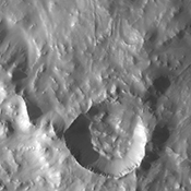 This image from NASA's Mars Odyssey spacecraft shows the southwest rim of Gale Crater, including a small, younger crater.