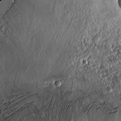 Moving eastward across the southern part of Gale Crater, this image from NASA's Mars Odyssey spacecraft shows the easternmost arc of the channel deposit at the far left edge. Towards the bottom of the frame are sand dunes.