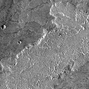Like yesterday's image, this image from NASA's Mars Odyssey spacecraft shows lava flows from Arsia Mons.
