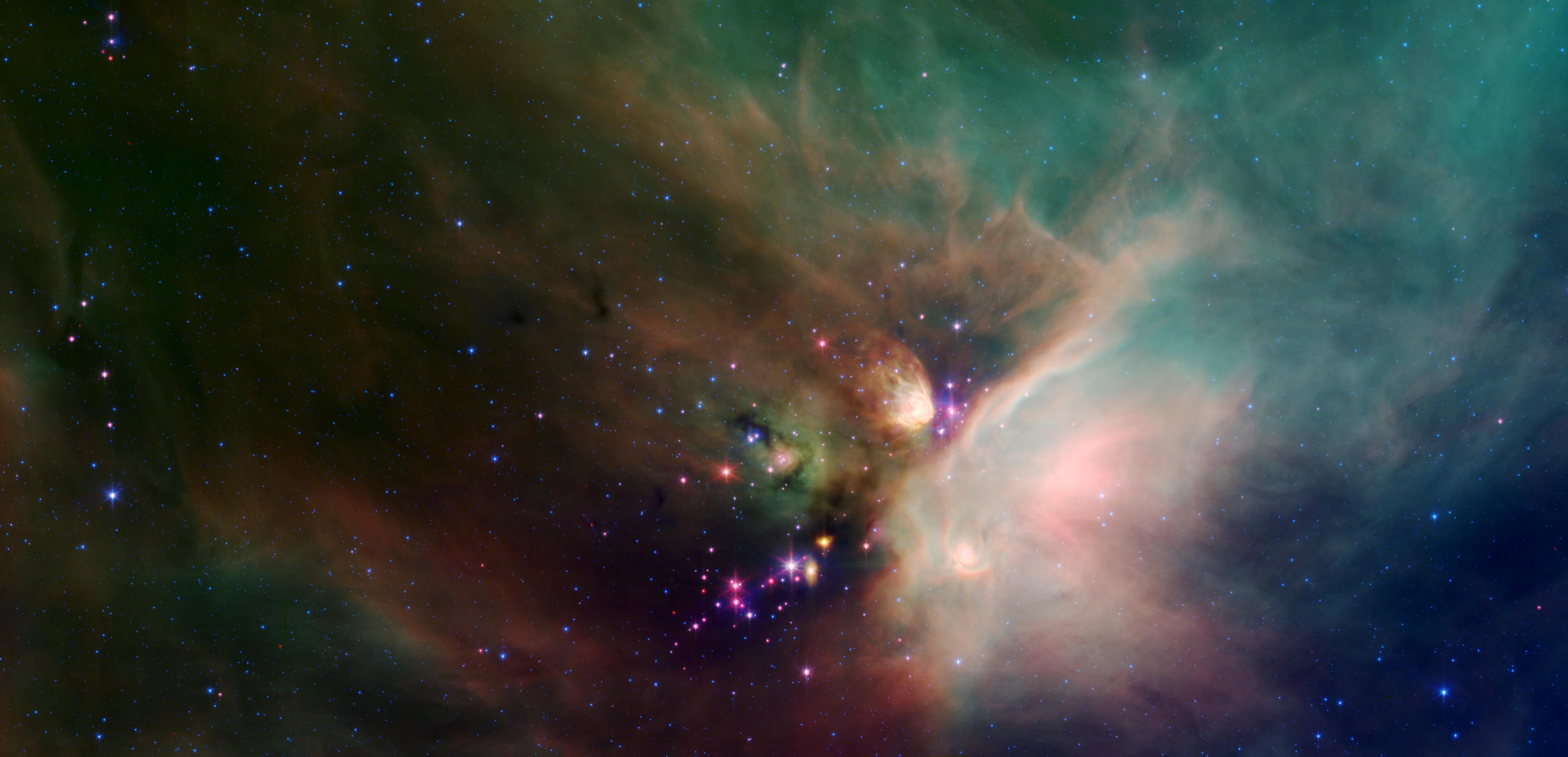 A blanket of green- and orange-colored stellar dust surrounds a grouping of purple, blue and red stars.