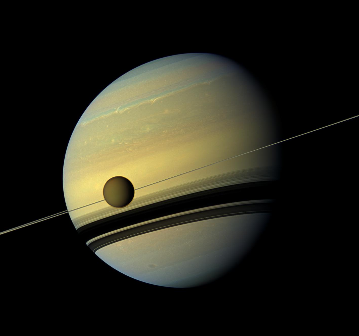 Titan the gray man writes saturns largest moon titan in front of the ringed planet nasa image from the cassini spacecraft sciox Image collections