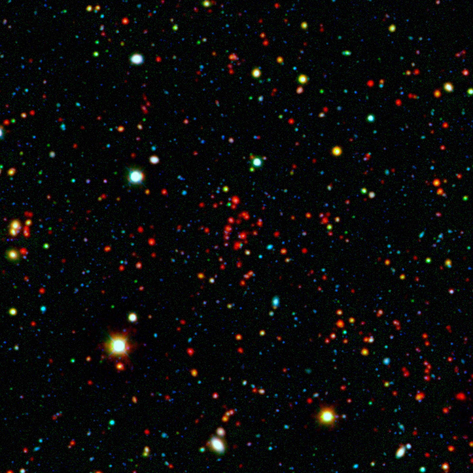 The collection of red dots seen here show one of several very distant galaxy clusters discovered