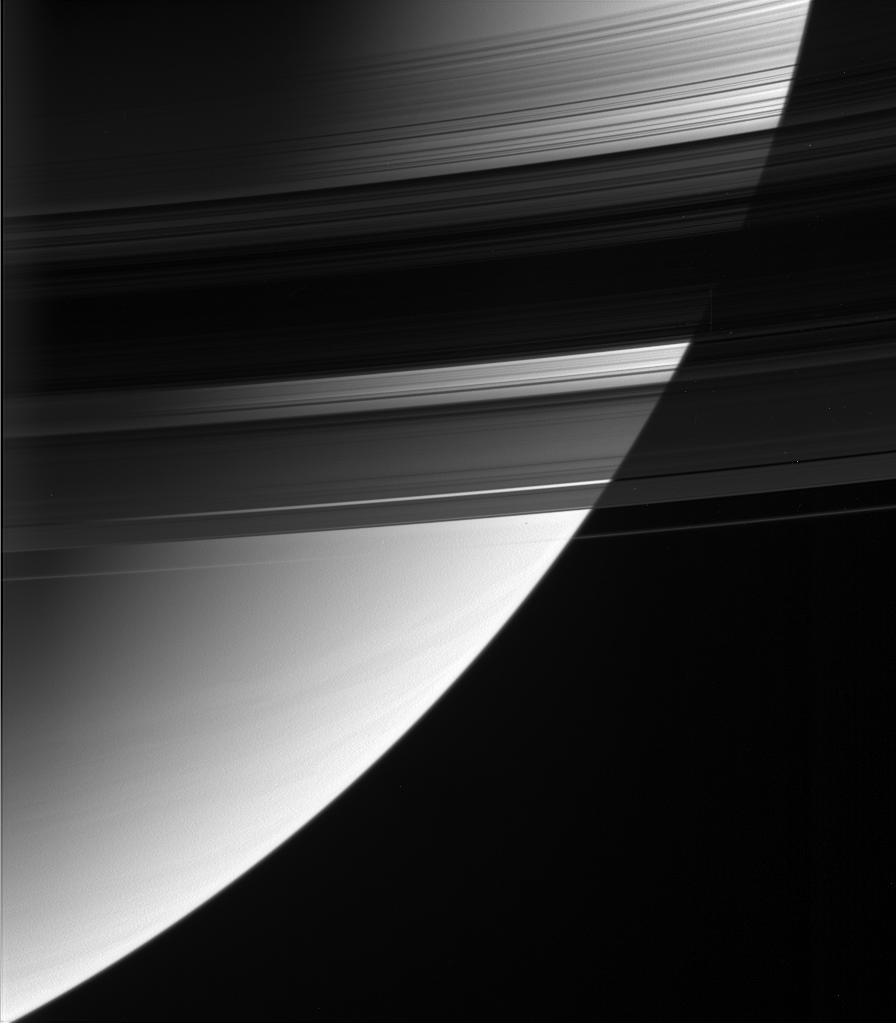 This magnificent view looks down upon, and partially through, Saturn's rings from their unlit side.
