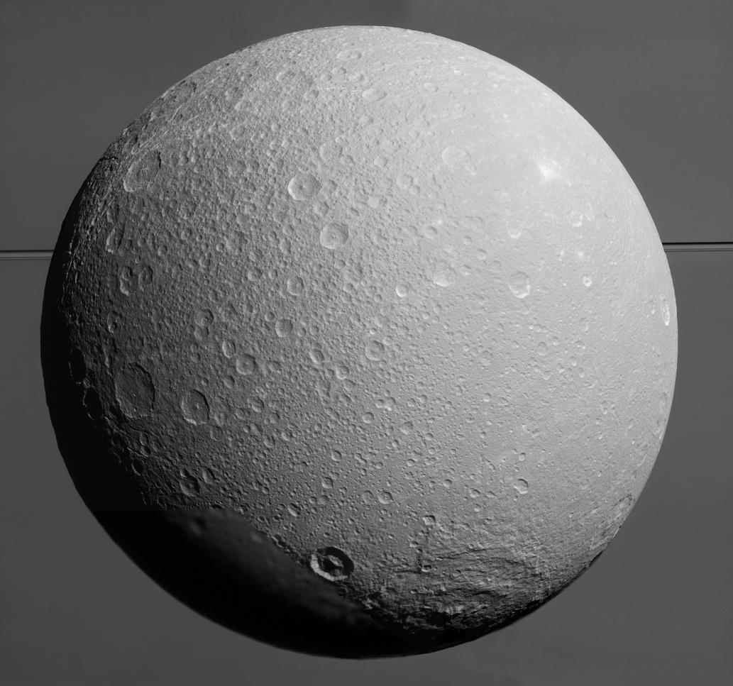 Dione with Saturn and its rings in the background. This image was taken by the Cassini spacecraft on 17 Augustus 2015 (NASA/JPL-Caltech/Space Science Institute http://photojournal.jpl.nasa.gov/catalog/PIA19650)