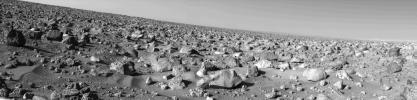 The rocky Martian plain surrounding NASA's Viking 2 is seen in high resolution in this 85-degree panorama sweeping from north at the left to east at right during the Martian afternoon on Sept. 5, 1976.