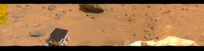 This image represents the first two tiers of a 360-degree color panorama, taken by NASA's Imager for Mars Pathfinder (IMP) on July 9, 1997. At left, the forward ramp is visible near the larger rocks.
