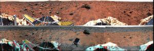 This panoramic view taken by NASA's Mars Pathfinder is a controlled mosaic of approximately 300 IMP images. 3D glasses are necessary to identify surface detail.