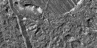 This view of the Conamara Chaos region on Jupiter's moon Europa taken by NASA's Galileo spacecraft shows an area where the icy surface has been broken into many separate plates that have moved laterally and rotated.