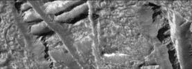 This view captured by NASA's Galileo spacecraft of the Conamara Chaos region on Jupiter's moon Europa shows cliffs along the edges of high-standing ice plates.