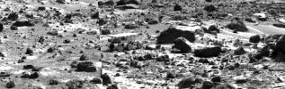 This image mosaic taken by NASA's Imager for Mars Pathfinder (IMP) shows the Sojourner rover near the large rock 'Chimp' on the afternoon of Sol 72 (September 15). Sol 1 began on July 4, 1997.