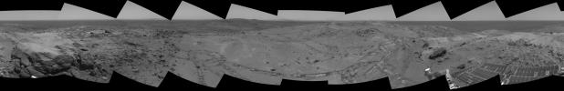 This view from NASA's Mars Exploration Rover Spirit taken on Oct 7, 2005 looked back at the long and winding trail of twin wheel tracks the rover created to get to the top of 'Husband Hill' perched on a lofty, rock-strewn incline.