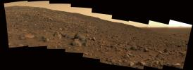 On June 19, 2005, NASA's Spirit rover took this true-color panorama nicknamed 'Sunset Ridge' showing the terrain that lay ahead of the rover.