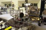 Rover 2 equipment deck, with solar arrays partially deployed, in NASA's JPL's Spacecraft Assembly Facility's cleanroom.