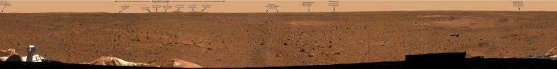 The arrows in this 360-degree panoramic view of the martian surface identify hills and craters on the martian horizon taken on Mars by the panoramic camera onboard NASA's Mars Exploration Rover Spirit.