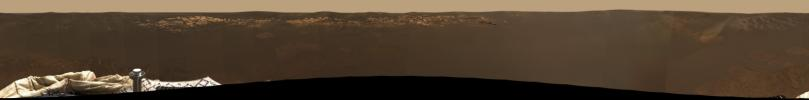 NASA's Mars Exploration Rover Opportunity shows the expansive view of the martian real estate. he airbag marks, or footprints, seen in the soil trace the route by which the rover rolled to its final resting spot inside a small crater at Meridiani Planum.