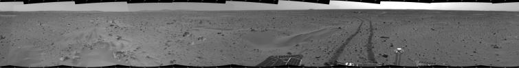 This 360-degree mosaic panorama image, taken by the navigation camera onboard NASA's Mars Exploration Rover Spirit, includes a view of the lander. The lander is to the south-southwest of the rover, which is moving toward a crater nicknamed 'Bonneville.'