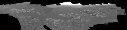NASA's Mars Exploration Rover Opportunity's shows two regions of the rock outcrop at Meridiani Planum, Mars. The region on the left, dubbed 'Charlie Flats,' was imaged because it contains an assortment of small grains, pebbles and spherules, as well as bo