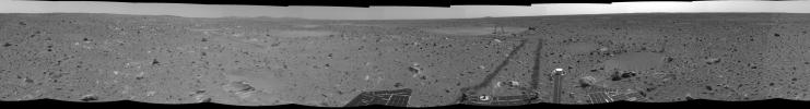 NASA's Mars Exploration Rover Spirit shows 'Laguna Hollow,' the shallow depression where Spirit dug a trench in 2004. Spirit stayed in this location for 3 sols, investigating the fine-grained soil and the trench it dug with one of its wheels.