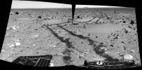 This pair of pieced-together images was taken by the Mars Exploration Rover, Spirit,  looking aft on March 6, 2004. It reveals the long and rocky path of nearly 787 feet that Spirit had traveled since safely arriving at Gusev Crater on Jan. 3, 2004.