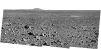 NASA's Mars Exploration Rover Spirit took this panoramic camera image on March 31, 2004 before driving 36 meters (118 feet) on sol 87 toward its future destination, the Columbia Hills. The large hill on the horizon is Grissom Hill.