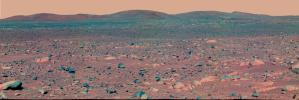 This false-color mosaic image from NASA's Mars Exploration Rover Spirit panoramic camera shows the view acquired on April 3, 2004. Colors have been exaggerated to enhance the differences between cleaner and dustier rocks, and lighter and darker soils.