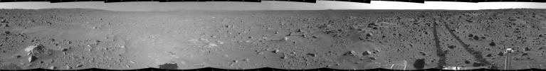 This cylindrical-projection mosaic was created by NASA's Mars Exploration Rover Spirit acquired on sol 93 (April 7, 2004). It reveals the martian view from Spirit's position during the four-sol flight software update that began on sol 94.