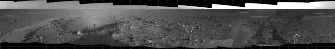 This 360-degree panorama taken by NASA's Mars Exploration Rover Spirit highlights the bumpy terrain surrounding the rover. Spirit's shadow can be seen in a small hollow lying between the rover and its intended target, the eastern-lying 'Columbia Hills.'