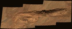 This image from the panoramic camera on NASA's Mars Exploration Rover Opportunity shows a trench dug by the rover in the vicinity of the 'Anatolia' region. Two imprints from the rover's Moessbauer spectrometer instrument were left in the exposed soils.