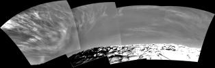 Clouds add drama to the sky above 'Endurance Crater' in this mosaic of frames taken by NASA's Mars Exploration Rover Opportunity on Nov. 16, 2004. The view spans an arc from east on the left to the southwest on the right.