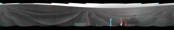 On Feb. 19, 2005, NASA's Mars Exploration Rover Opportunity set a one-day distance record for martian driving; Opportunity rolled 177.5 meters (582 feet) across the plain of Meridiani. 3D glasses are necessary to view this image.
