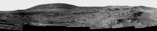 This image shows a sweeping black-and-white panorama of the rounded, knob-like peak of
