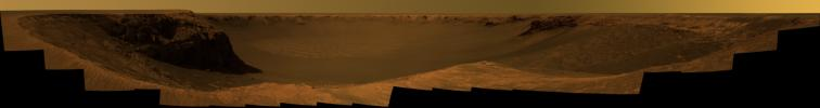 NASA's Mars Exploration Rover Opportunity captured this vista of 'Victoria Crater' from the viewpoint of 'Cape Verde,' one of the promontories that are part of the scalloped rim of the crater.