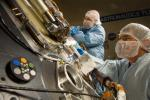 Lockheed Martin Space Systems technicians work on the science deck of NASA's Phoenix Mars Lander.