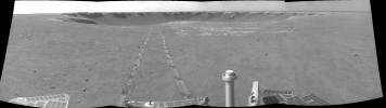 This image from NASA's Mars Exploration Rover Opportunity gives a view to the northeast from the rover's position on Oct. 18, 2008. Rover tracks are seen on Victoria Crater.